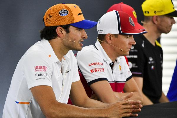 Carlos Sainz Jr, McLaren, Kimi Raikkonen, Alfa Romeo Racing and Nico Hulkenberg, Renault F1 Team In the Press Conference