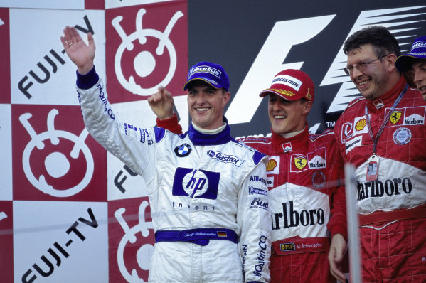Ralf Schumacher celebrates 2nd position on the podium.