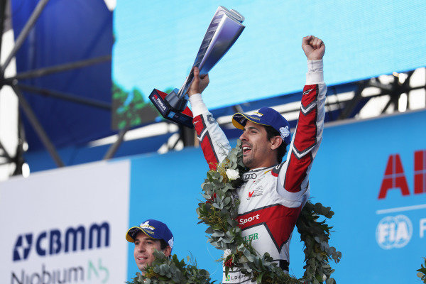 Lucas Di Grassi (BRA), Audi Sport ABT Schaeffler, celebrates with his trophy on the podium.