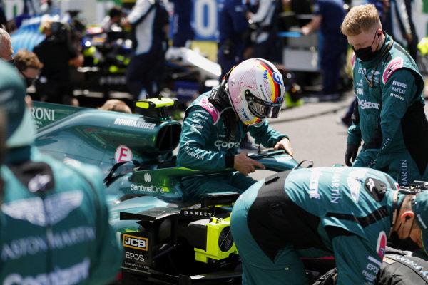 Sebastian Vettel, Aston Martin AMR21, gets in his car on the grid