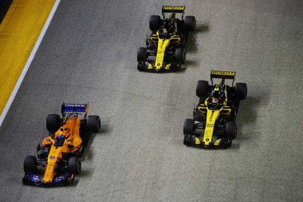Fernando Alonso, McLaren MCL33, leads Carlos Sainz Jr., Renault Sport F1 Team R.S. 18, and Nico Hulkenberg, Renault Sport F1 Team R.S. 18