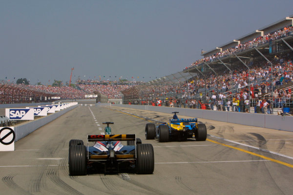 2002 American Grand Prix.Indianapolis, Indiana, USA. 27-29 September 2002.A Minardi PS02 Asiatech and a Renault R202 go down the pit lane.World Copyright - LAT Photographicref: Digital File Only