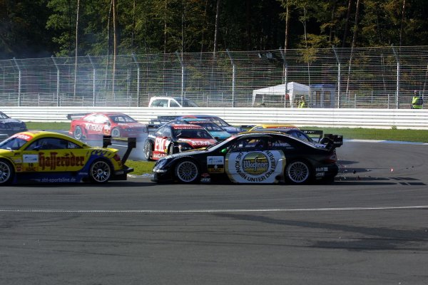 2002 DTM Championship.Hockenheim, Germany. 5-6 October 2002.As Christian Abt (Abt Audi TT-R) exits the Spitzkehre, Marcel Fassler (HWA/Mercedes CLK DTM), Johnny Cecotto (Euroteam/Opel Astra V8 Coupe DTM) and Jean Alesi (HWA/Mercedes CLK DTM) all collide behind. World Copyright - Andre Irlmeier/LAT PhotographicSpitzkehre sequence - 2.