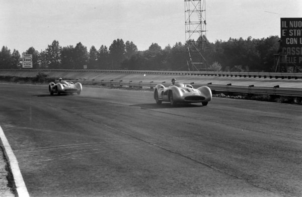 Juan Manuel Fangio, Mercedes W196, leads Stirling Moss, Mercedes W196.