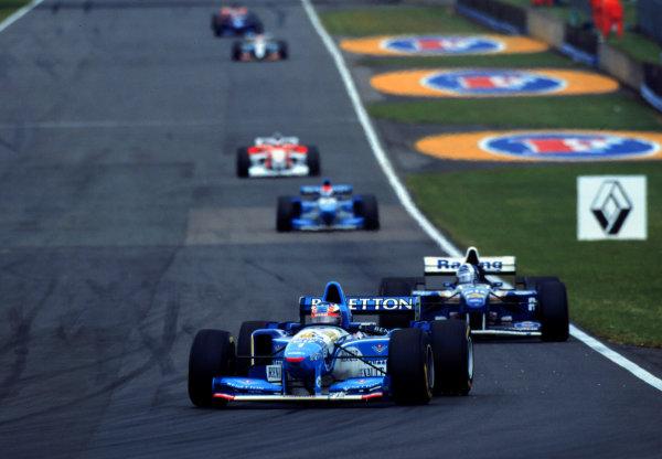 1995 British Grand Prix.Silverstone, England.14-16 July 1995.Michael Schumacher (Benetton B195 Renault) leads Damon Hill (Williams FW17 Renault).World Copyright - LAT Photographic