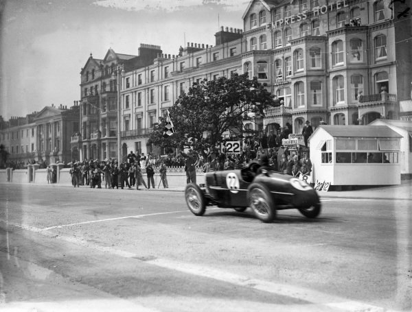 Norman Black, MG K3 Magnette, crosses the line and takes the chequered flag.