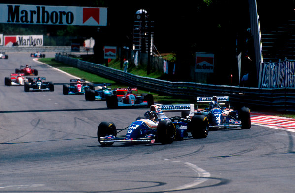 1994 Belgian Grand Prix.Spa-Francorchamps, Belgian.26-28 August 1994.Damon Hill followed by teammate David Coulthard (both Williams FW16B Renault's) into La Source HairpinRef-94 BEL 11.World Copyright - LAT Photographic