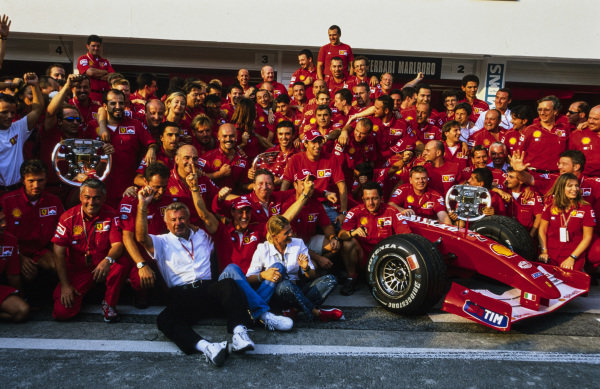 The Ferrari team celebrates securing both the drivers' and constructors' world championships.