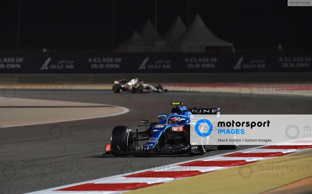 Esteban Ocon, Alpine A521, leads Mick Schumacher, Haas VF-21