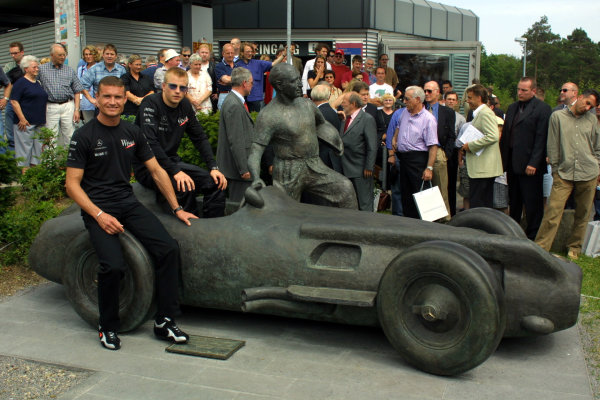 2002 European Grand Prix - PreviewKimi Raikkonen and David Coulthard unveil a new statue of Juan Manuel Fangio.Nurburgring, Germany. 20th June 2002.World Copyright: PicMe / LAT Photographic.ref: Digital Image Only