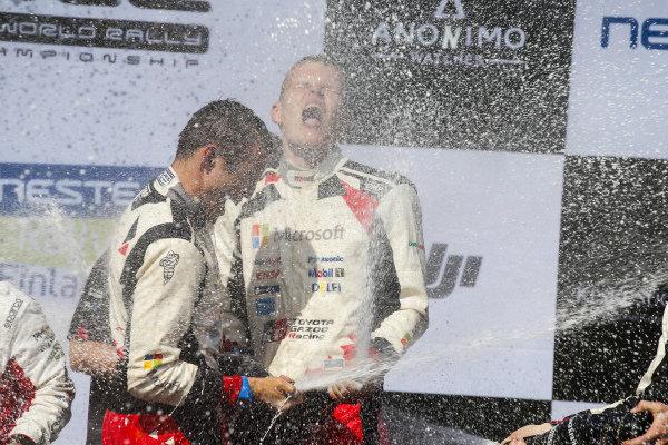 Ott Tanak amidst the podium champagne celebrations