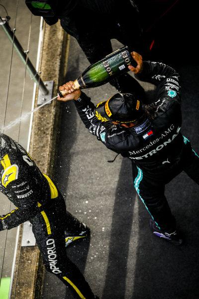 Lewis Hamilton, Mercedes-AMG Petronas F1, 1st position, blasts Daniel Ricciardo, Renault F1, 3rd position, with Champagne on the podium