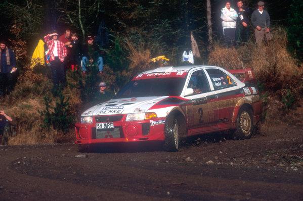 1998 World Rally ChampionshipNetwork Q, United Kingdom. 21st - 24th November 1998.Richard Burns' first WRC win on home soil. Mitsubishi Lancer, actionWorld Copyright: Martyn Elford/LAT Photographic
