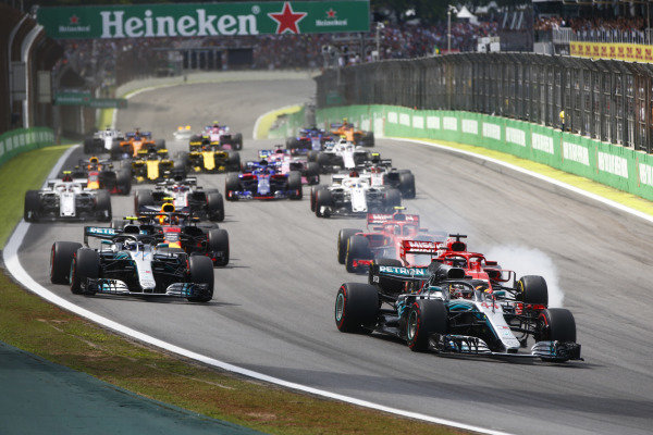 Lewis Hamilton, Mercedes AMG F1 W09 EQ Power+, leads Valtteri Bottas, Mercedes AMG F1 W09 EQ Power+, Sebastian Vettel, Ferrari SF71H, Kimi Raikkonen, Ferrari SF71H, Max Verstappen, Red Bull Racing RB14, and the rest of the field at the start