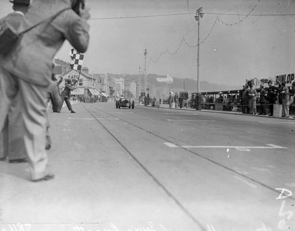 Brian Lewis, Bugatti T59, crosses the line and takes the chequered flag.