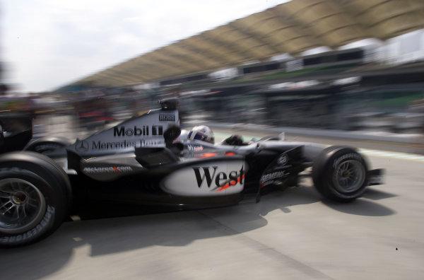 2001 Malaysian Grand Prix.Sepang, Kuala Lumpur, Malaysia. 16-18 March 2001.David Coulthard (McLaren MP4/16 Mercedes) exits the pits.World Copyright - Etherington/LAT Photographicref: 18mb digital image.