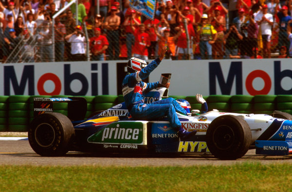 Hockenheim, German.26-28 July 1996.Gerhard Berger gets a lift back to the pits with teammate Jean Alesi (Benetton B196 Renault) after being 3 laps from victory.Ref-96 GER 10.World Copyright - LAT Photographic