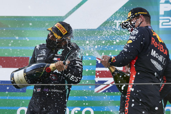 Lewis Hamilton, Mercedes-AMG Petronas F1, 1st position, and Max Verstappen, Red Bull Racing, 2nd position, spray Champagne on the podium