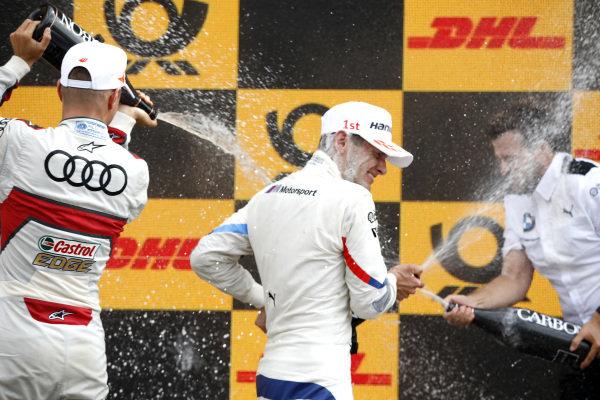 Podium: Race winner Marco Wittmann, BMW Team RMG, Nico Müller, Audi Sport Team Abt Sportsline.