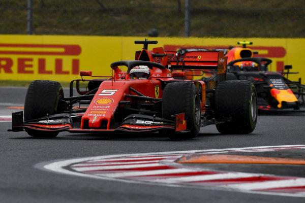 Sebastian Vettel, Ferrari SF90, leads Pierre Gasly, Red Bull Racing RB15