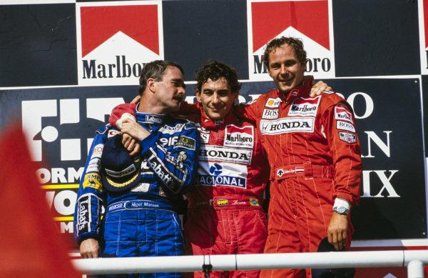 Ayrton Senna, newly-crowned world champion Nigel Mansell and Gerhard Berger, on the podium.