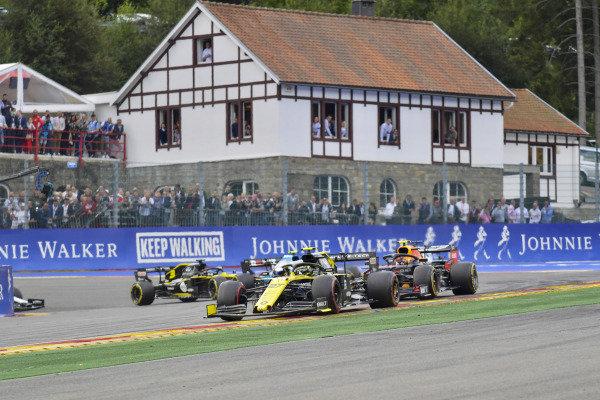 Nico Hulkenberg, Renault R.S. 19, leads Alexander Albon, Red Bull RB15, and Robert Kubica, Williams FW42