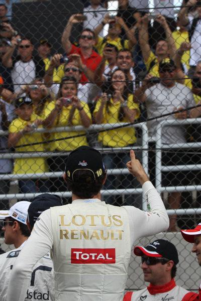 Bruno Senna (BRA) Lotus Renault GP on the drivers parade. Formula One World Championship, Rd 19, Brazilian Grand Prix, Race Day, Interlagos, Sao Paulo, Brazil, Sunday 27 November 2011.   BEST IMAGE
