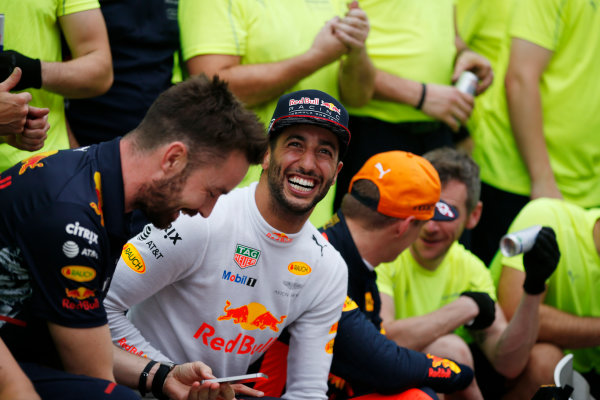 Sepang International Circuit, Sepang, Malaysia. Sunday 01 October 2017. Daniel Ricciardo, Red Bull Racing, celebrates alongside winner Max Verstappen, Red Bull Racing.  World Copyright: Zak Mauger/LAT Images  ref: Digital Image _X0W9230
