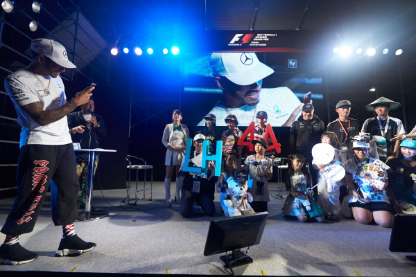 Suzuka Circuit, Japan. Saturday 7 October 2017. Lewis Hamilton, Mercedes AMG, with fans on stage. World Copyright: Steve Etherington/LAT Images  ref: Digital Image SNE14163