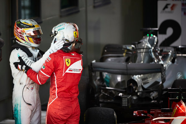 Albert Park, Melbourne, Australia. Sunday 26 March 2017. Sebastian Vettel, Ferrari, 1st Position, and Lewis Hamilton, Mercedes AMG, 2nd Position, congratulate each other in Parc Ferme.  World Copyright: Steve Etherington/LAT Images ref: Digital Image SNE25216