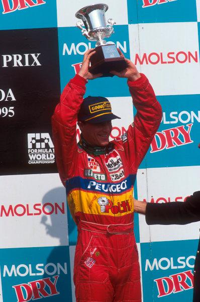 Montreal, Quebec, Canada.9-11 June 1995.Eddie Irvine (Jordan Peugeot) celebrates taking 3rd position, also his first podium.Ref-95 CAN 08.World Copyright - LAT Photographic