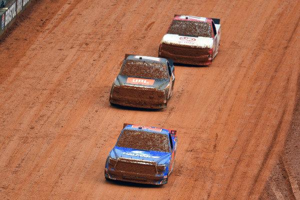 #52: Stewart Friesen, Halmar Friesen Racing, Toyota Tundra Halmar International, #18: Chandler Smith, Kyle Busch Motorsports, Toyota Tundra JBL and #22: Austin Wayne Self, AM Racing, Chevrolet Silverado GOTEXAN/AM