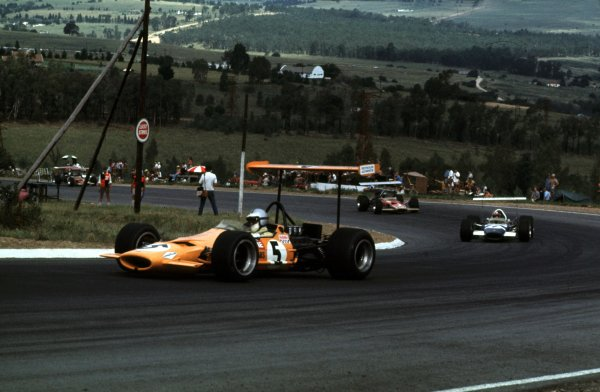 1969 South African Grand Prix.Kyalami, South Africa.27/2-1/3 1969.Denny Hulme (McLaren M7A Ford) leads Jo Siffert and Mario Andretti (both Lotus 49B Ford). Hulme and Siffert finished in 3rd and 4th positions respectively.Ref-69 SA 36.World Copyright - LAT Photographic