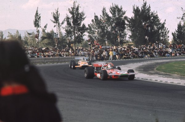 1970 Mexican Grand Prix.Mexico City, Mexico.23-25 October 1970.Chris Amon (March 701 Ford) leads Denny Hulme (McLaren M14A Ford). They finished in 4th and 3rd positions respectively.Ref-70 MEX 56.World Copyright - LAT Photographic