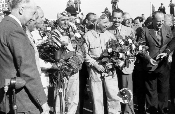Reg Parnell, Giuseppe Farina, and Luigi Fagioli recede their garlands.