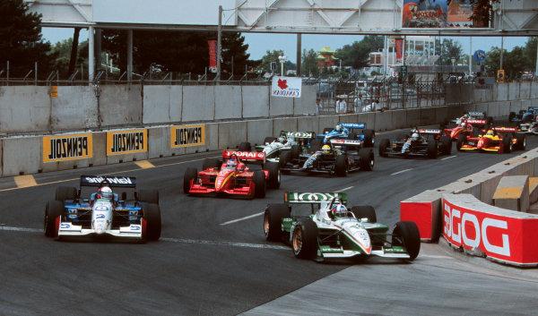 1999 CART Toronto G P.Dario Franchitti passes Gil deFerran at turn 1-1999, David ChessonLAT PHOTOGRAPHIC