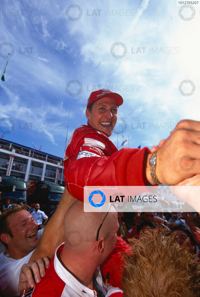 2002 French Grand Prix.Magny-Cours, France. 19-21 April 2002.Michael Schumacher (Ferrari) celebrates his 1st position and record equalling 5th formula one drivers World Championship in the paddock.Ref-02 FRA 44.World Copyright - LAT Photographic