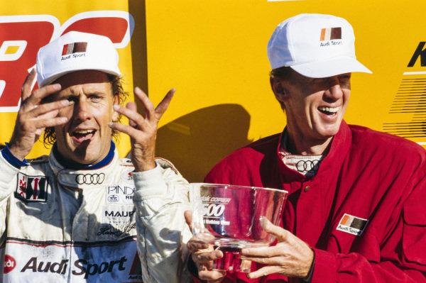 Hans-Joachim Stuck and Walter Röhrl celebrate.