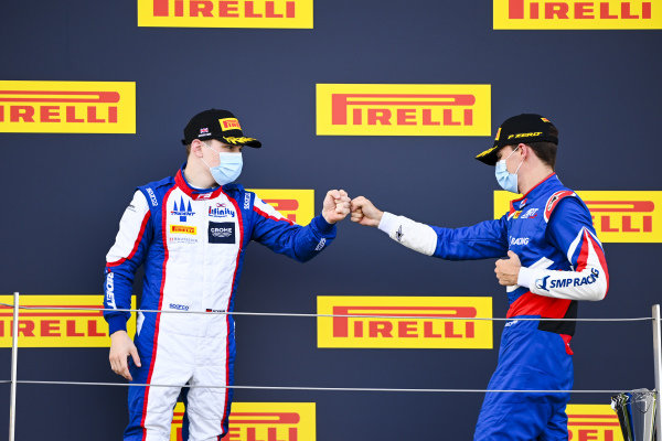 David BECKMAN (DEU, TRIDENT MOTORSPORT) and Race Winner Alexander Smolvar (RUS, ART GRAND PRIX) celebrate on the podium