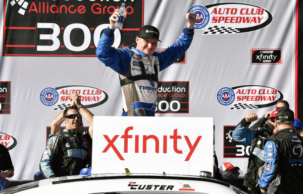 #00: Cole Custer, Stewart-Haas Racing, Ford Mustang Thompson Pipe/Haas CNC celebrates his win in Victory Lane