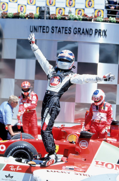 2004 United States Grand Prix. Indianapolis, USA. 18th - 19th June.Takuma Sato, BAR Honda 006 celebrates his third place whilst standing on his car. Action. World Copyright:LAT Photographic35mm image: A22
