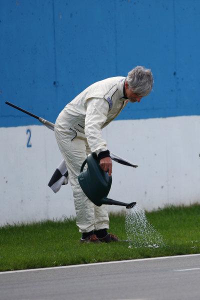 2014 British Formula 3 International Series, Media Day. Donington Park, Leicestershire. 8th April 2014. Damon Hill (GBR) watering the grass at DoningtonWorld Copyright: Jakob Ebrey / LAT Photographic