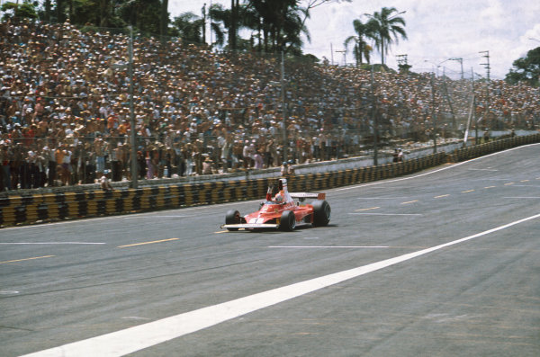 Interlagos, Sao Paulo, Brazil. 23-25 January 1976. Niki Lauda, Ferrari 312T, crosses the finish line to take the win. Ref: 76BRA08. World Copyright - LAT Photographic