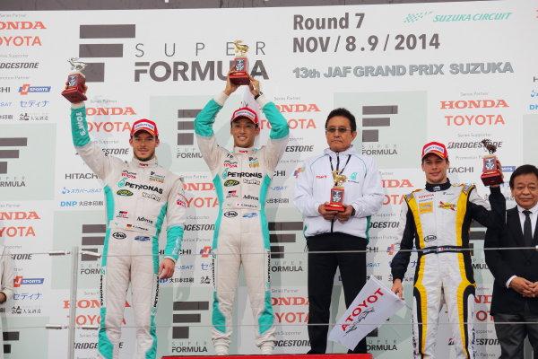 2014 Super Formula Series. Suzuka, Japan. 9th - 10th November 2014. Rd 7. Race 2 - Winner Kazuki Nakajima ( #37 TEAM TOM'S SF14 )  2nd position Andre Lotterer ( #36 PETRONAS TOM'S SF14 ) 3rd position Loic Duval ( #8 Team KYGNUS SUNOCO SF14 ) podium, portrait World Copyright: Yasushi Ishihara / LAT Photographic. Ref:  2014_SF_Rd7_020.JPG