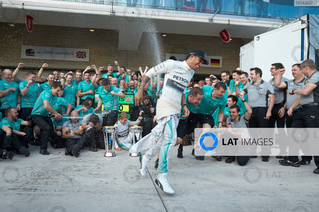 Circuit of the Americas, Austin, Texas, United States of America. Sunday 2 November 2014. Lewis Hamilton, Mercedes AMG celebrates with the team and Nico Rosberg, Mercedes AMG after winning the race. World Copyright: Steve Etherington/LAT Photographic. ref: Digital Image SNE25063