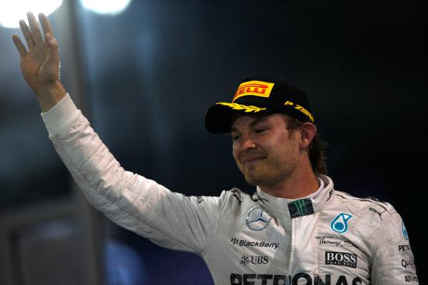 Yas Marina Circuit, Abu Dhabi, United Arab Emirates. Sunday 29 November 2015. Nico Rosberg, Mercedes AMG, 1st Position, arrives on the podium. World Copyright: Charles Coates/LAT Photographic ref: Digital Image _99O2636
