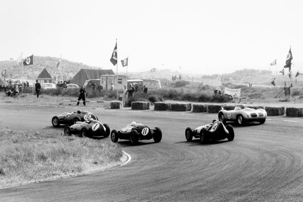 Zandvoort, Holland. 31 May 1959.Cliff Allison, Ferrari Dino 246, 9th position, leads Jean Behra, Ferrari Dino 246, 5th position, Stirling Moss, Cooper T51-Climax, retired, Graham Hill, Lotus 16-Climax, 7th position, and Carel Godin de Beaufort, #15 Porsche RSK, 10th position, action.World Copyright: LAT PhotographicRef: Autosport b&w print. Published: Autosport, 5/6/1959 p729