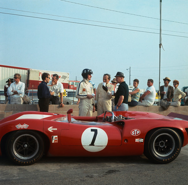 Riverside, California, USA. 30th October 1966. Rd 5.John Surtees (Lola T70 Mk 2 Chevrolet), 1st position, in conversation with Graham Hill in the pits, portrait. World Copyright: LAT Photographic.Ref:  2403.