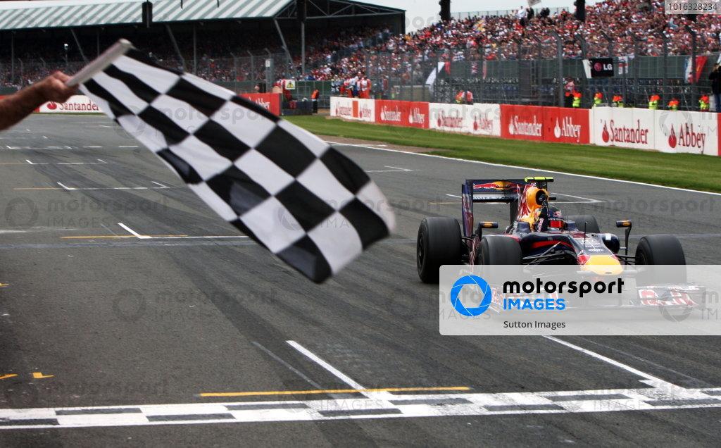 Race winner Sebastian Vettel (GER) Red Bull Racing RB5 takes the chequered flag. Formula One World Championship, Rd 8, British Grand Prix, Race, Silverstone, England, Sunday 21 June 2009. BEST IMAGE