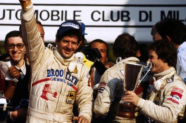 (L to R): Race winner and World Championship Jody Scheckter (RSA) celebrates on the podium with second placed team mate Gilles Villeneuve (CDN) Ferrari. Italian Grand Prix, Rd 13, Monza, Italy, 9 September 1979. BEST IMAGE